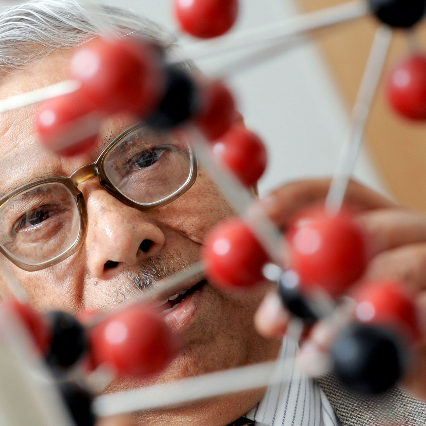 Man with molecular structure model