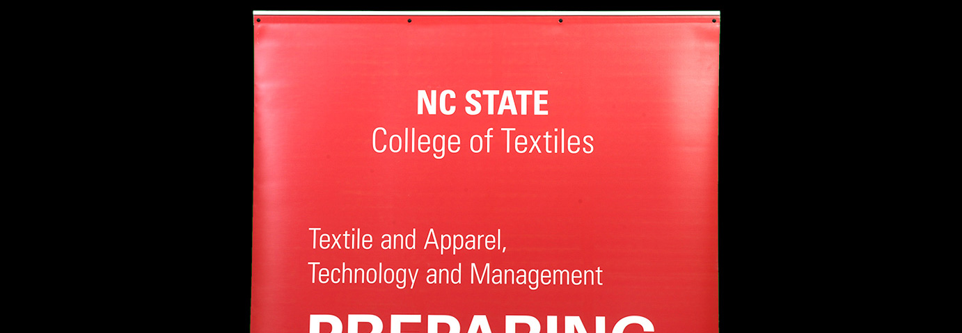 Photo of College of Textiles departmental logo on banner