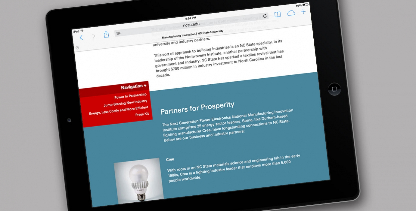 Photo of iPad with NC State website